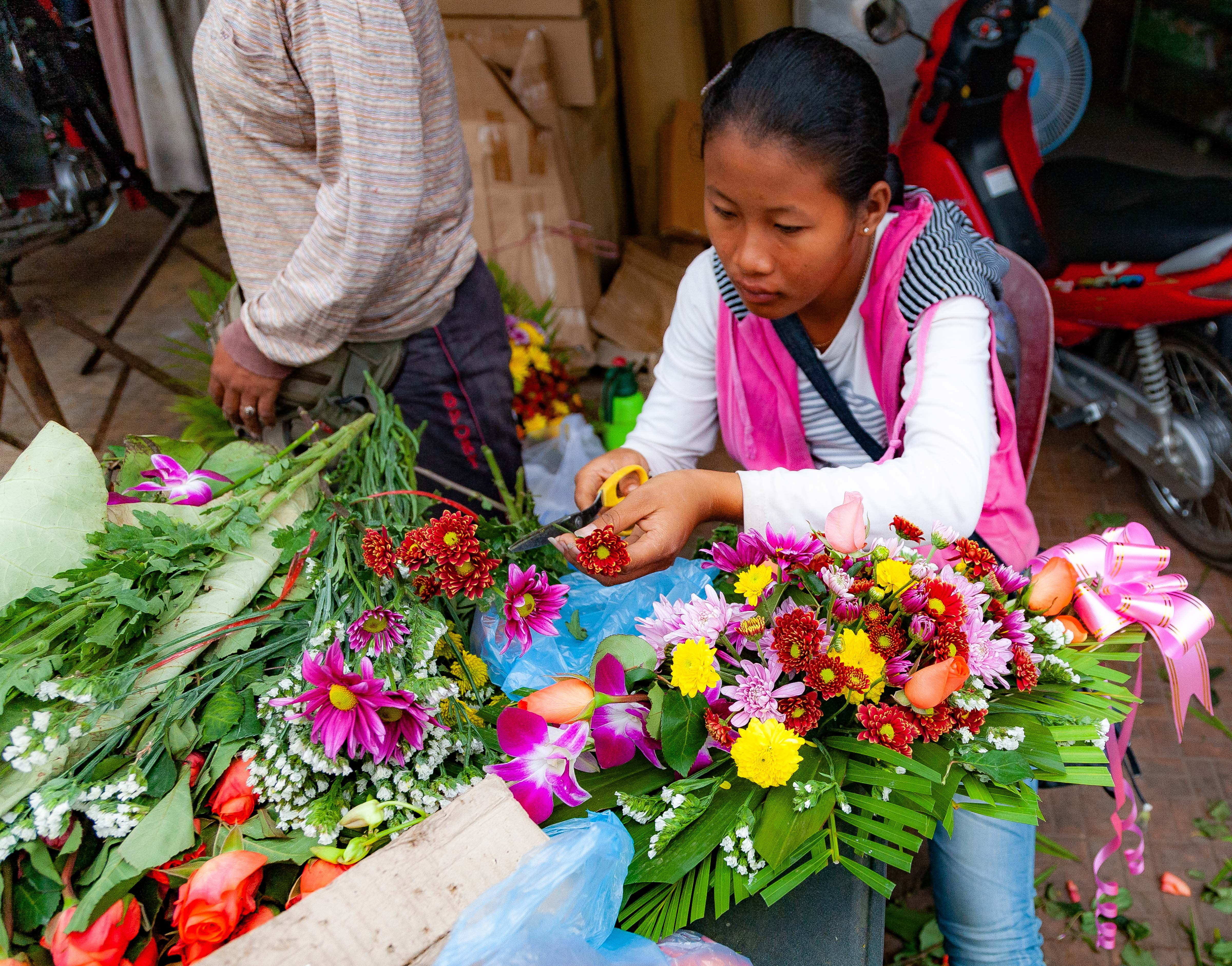 Cambodia, Kampong Chaam Prov, Flower Vendor, 2010, IMG 5352