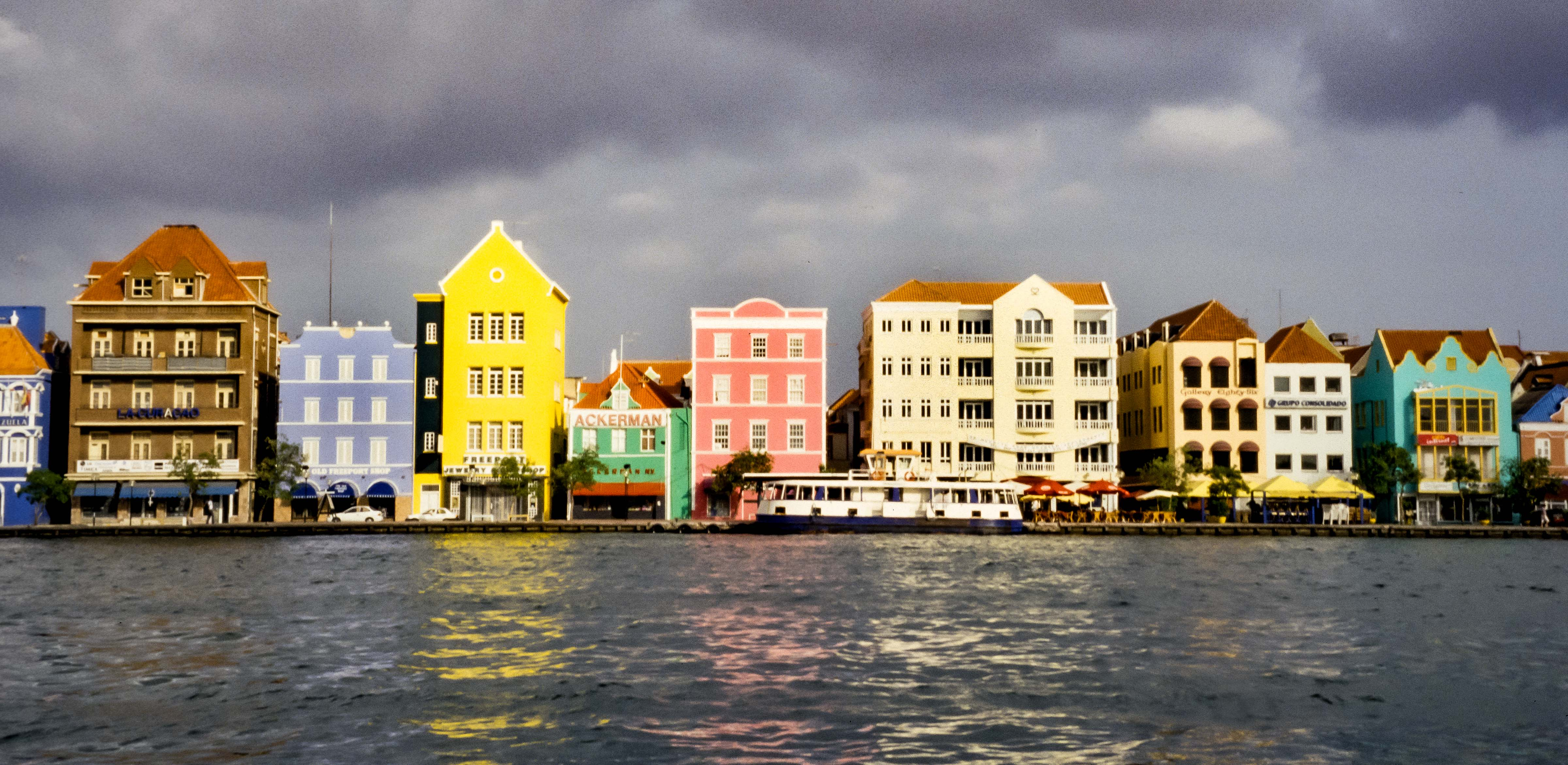 Curacao, Waterfront Promenade, 2000 – This section of waterfront in Curacao is notable because of its varied architecture and color.
