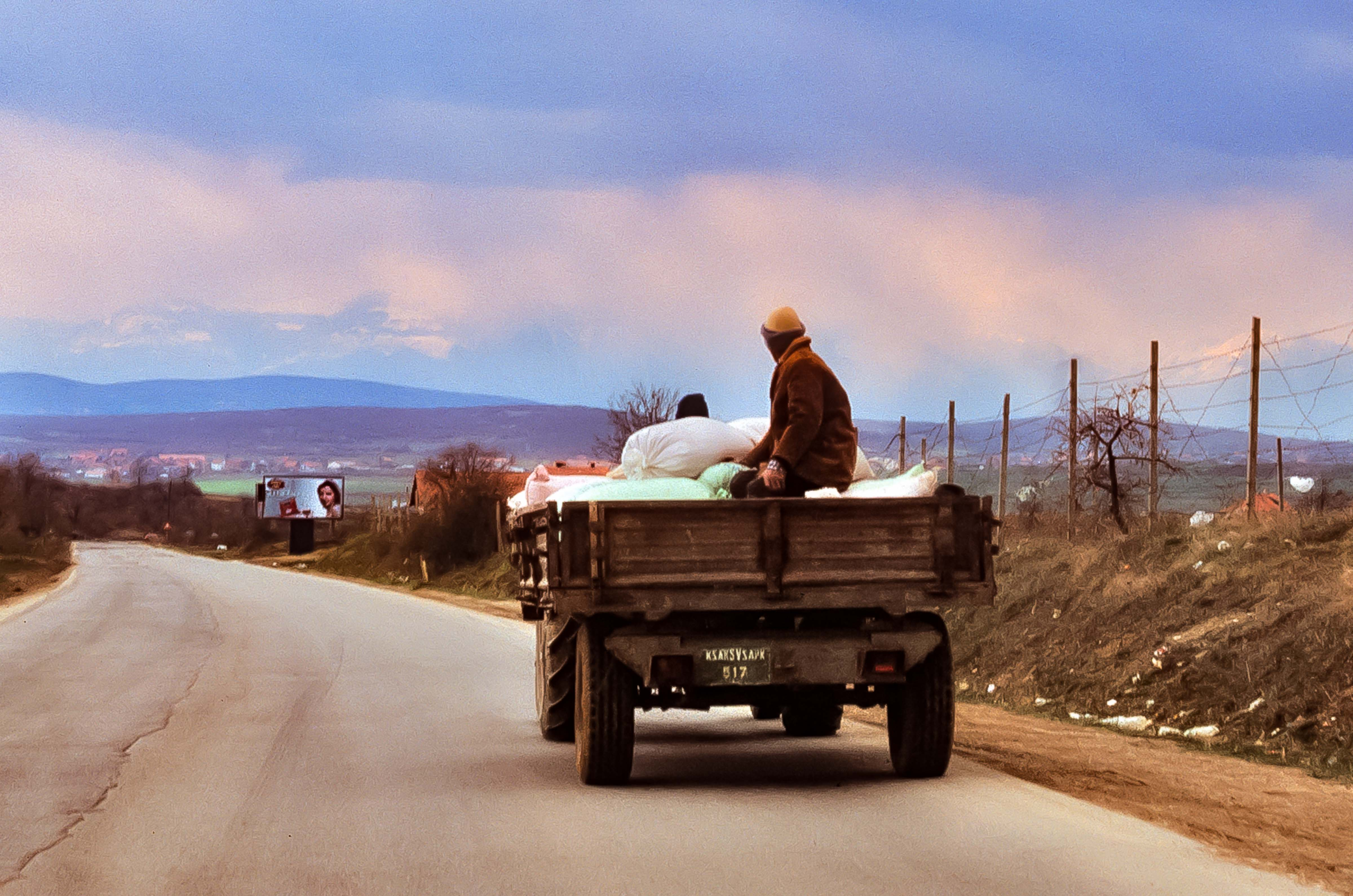 Kosovo, Riding The Back Of The Truck, 2003