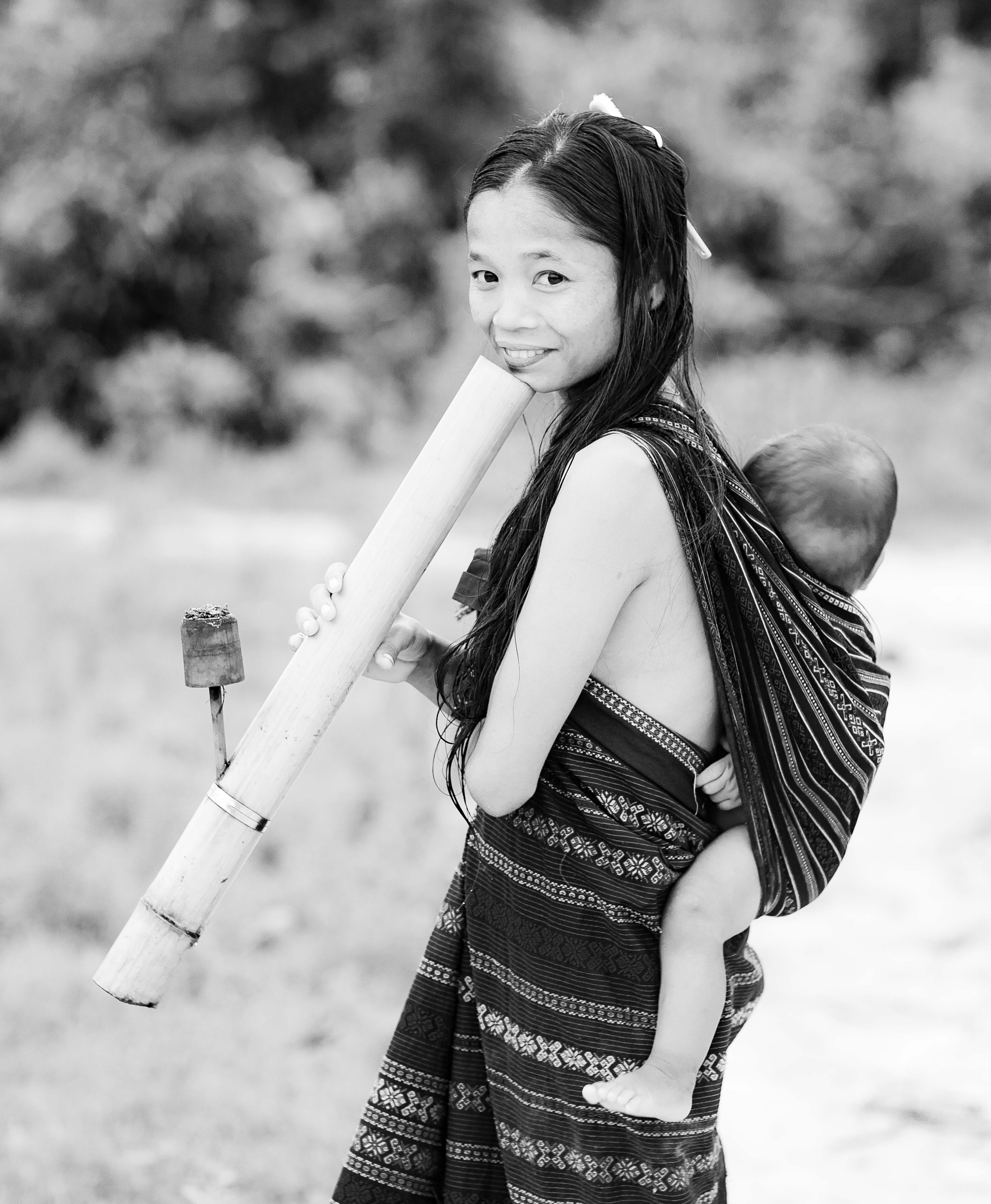 Laos, Xekong Prov, Woman With Pipe And Child, 2011, IMG 3967BW