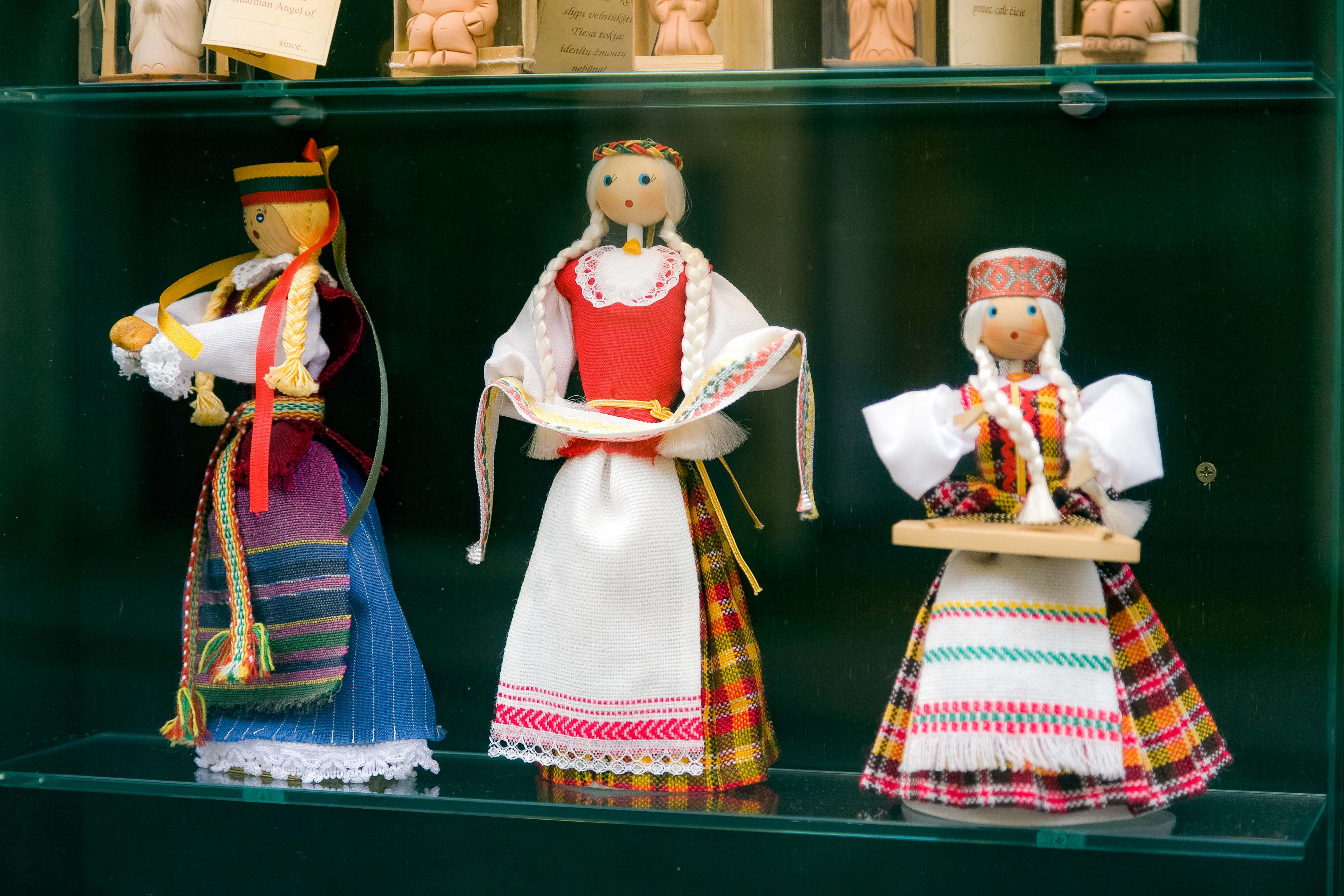 Lithuania, Vilnius, Three Dolls In Window, 2010, IMG_3100