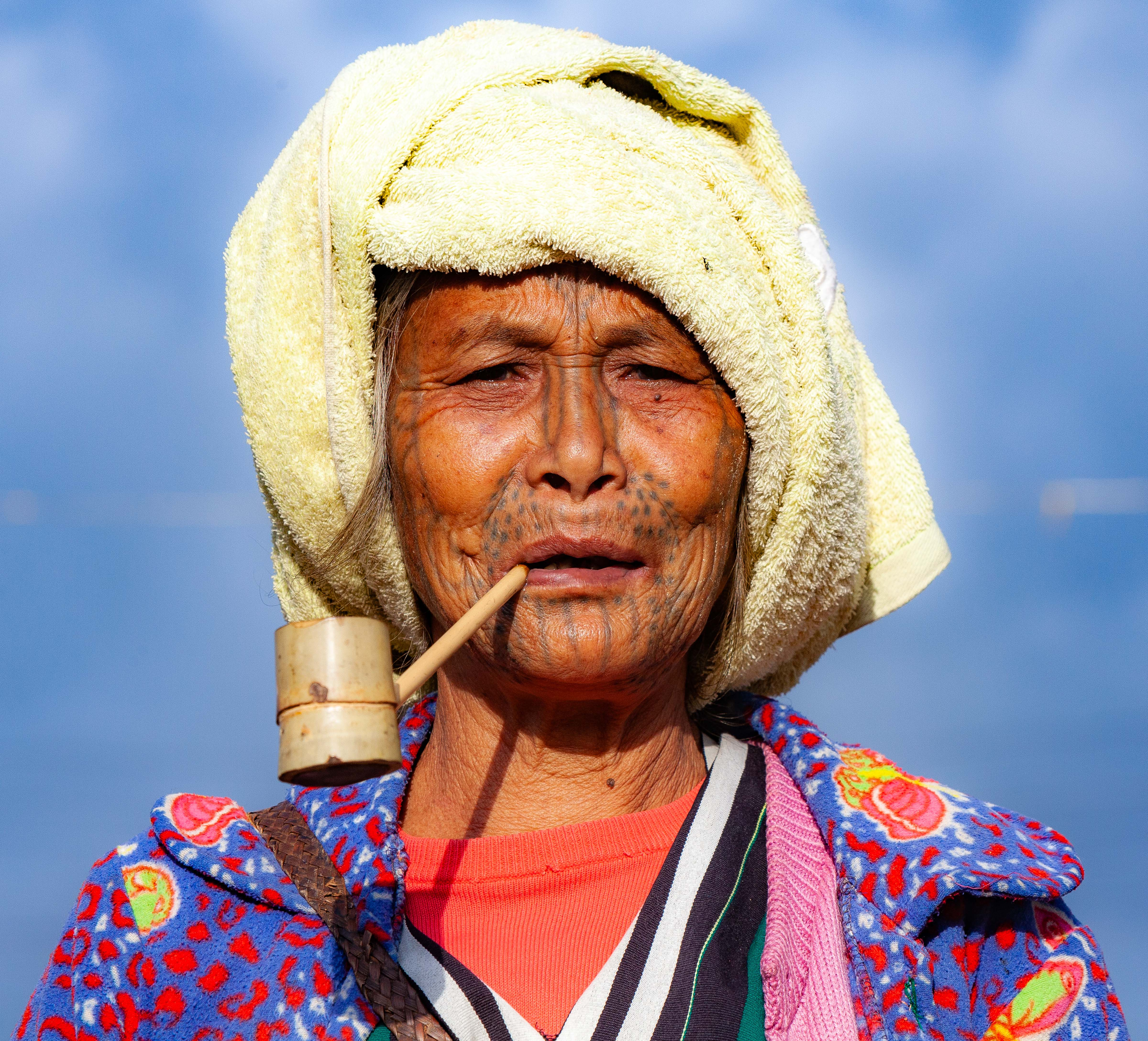 Myanmar, Chin Prov, Tattoo-Faced Woman With Pipe, 2012, IMG 2584