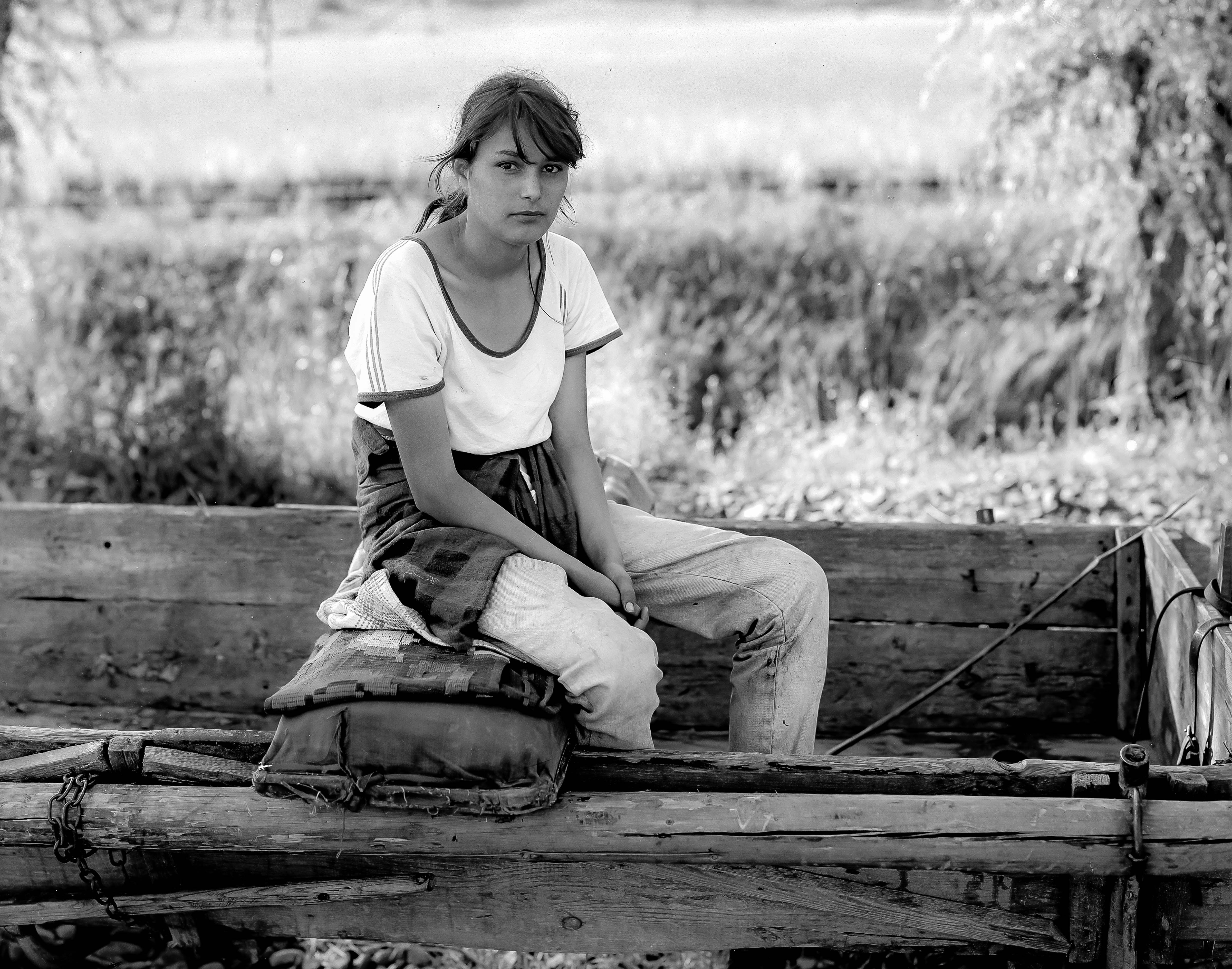 Romania, Farm Girl Sitting On Wagon, 1997