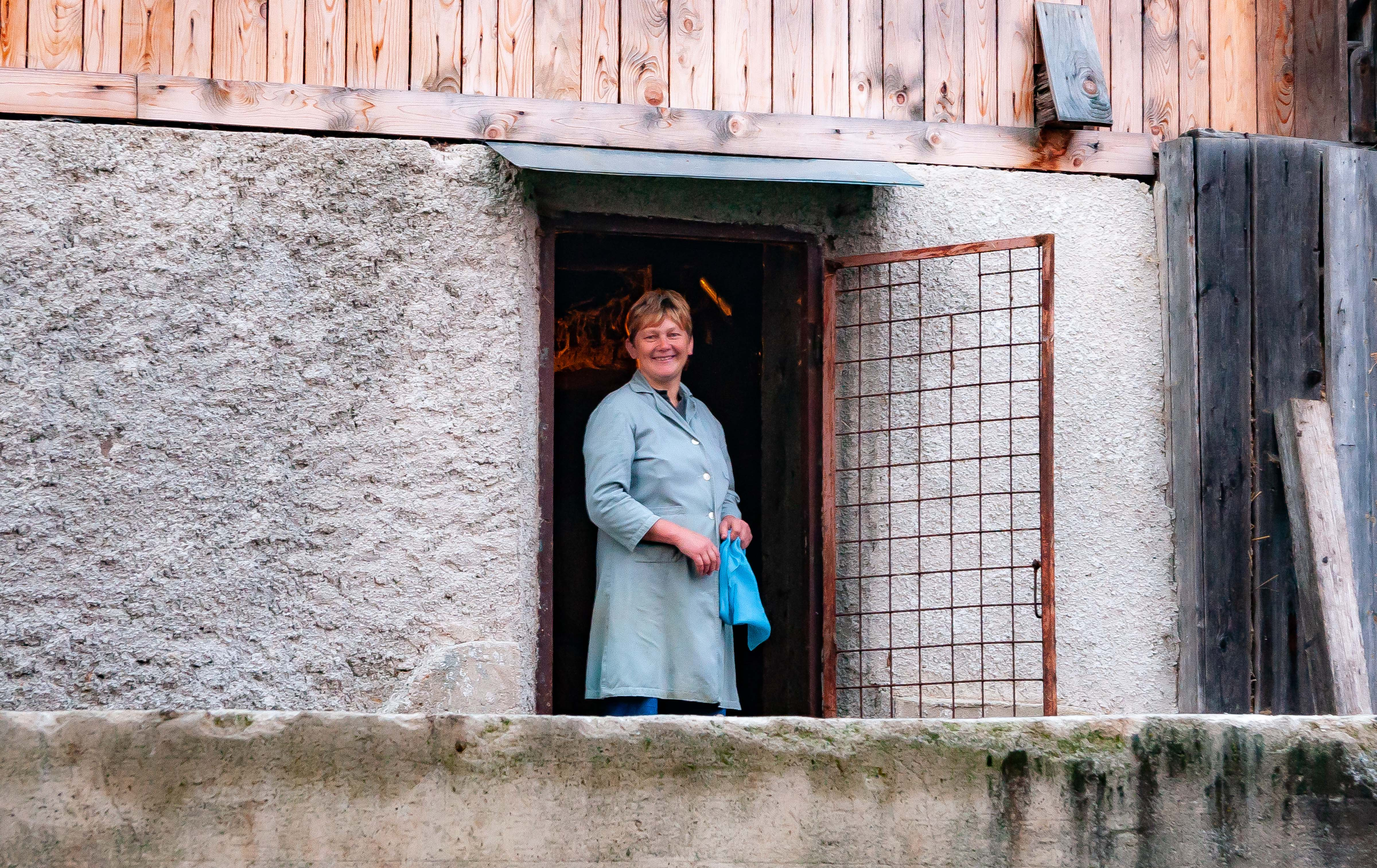 Slovenia, Dobrna Prov, Mother At Door To Stable Under The House, 2006, IMG 8074