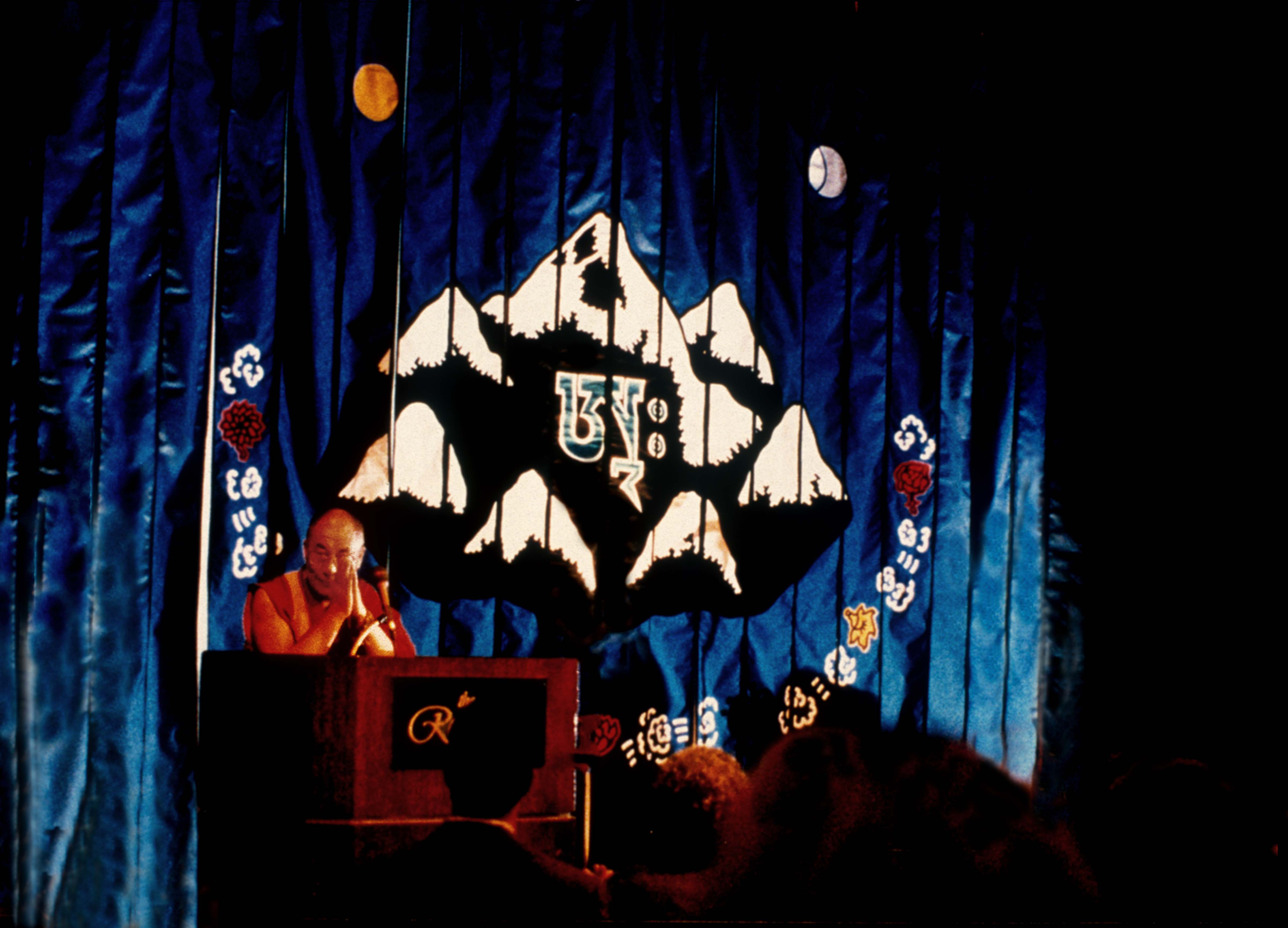 Dalai Lama Speaking in front of Seven Summits Banner