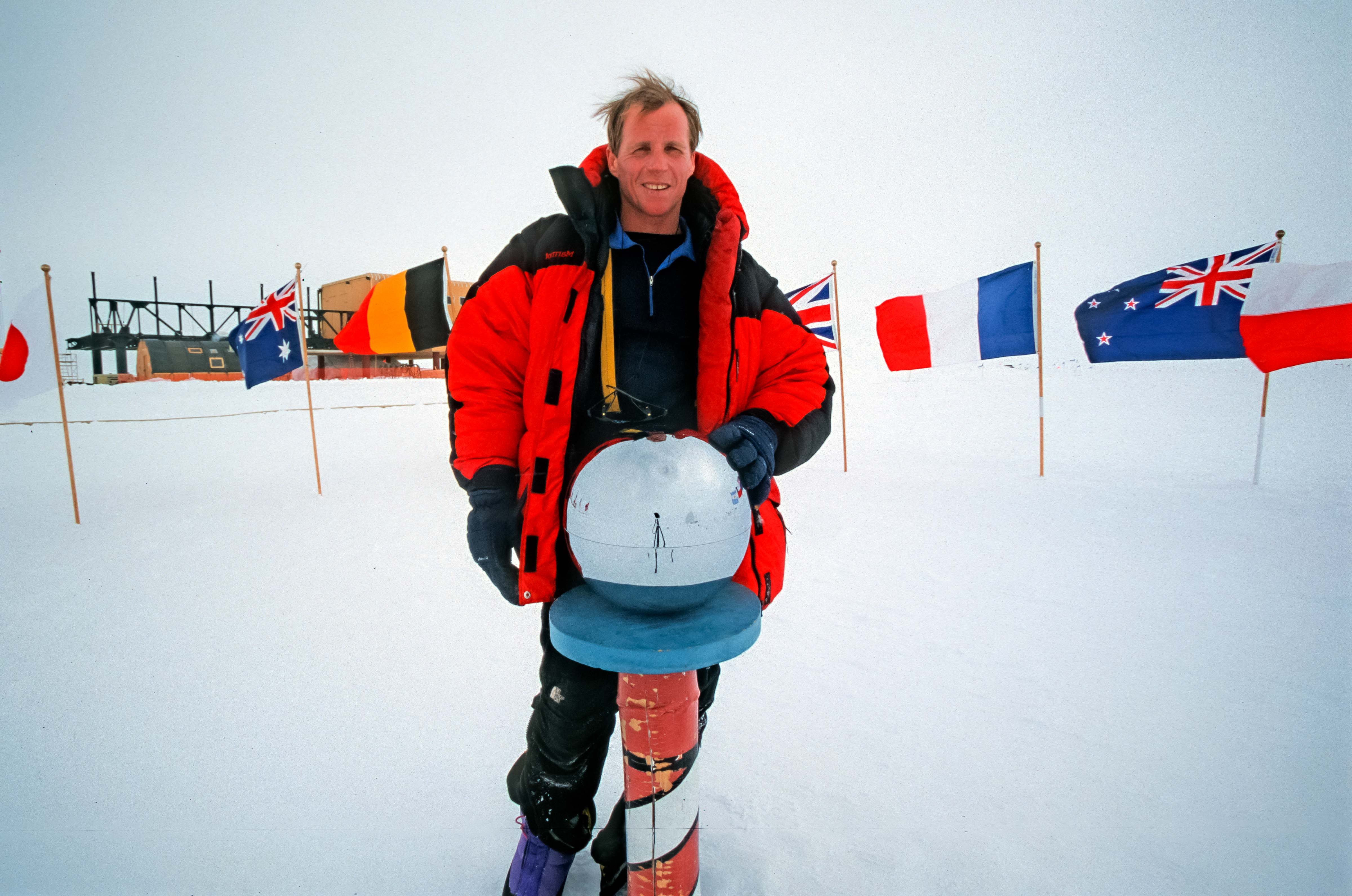 Antarctica, Jeff Shea at South Pole with Globe, 2001