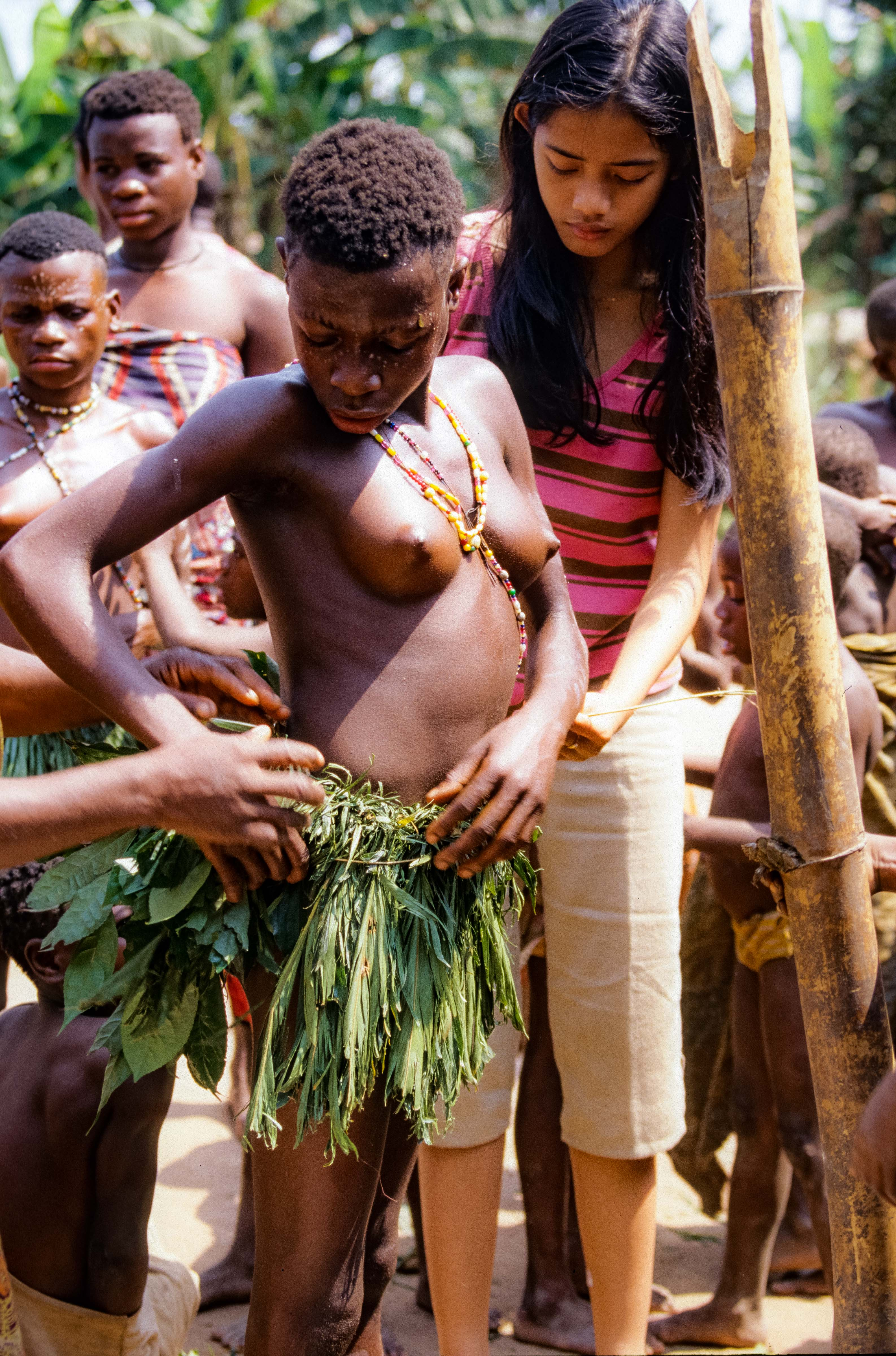 Central African Republic, Pygmy Girl Fastening Her Skirt, 2000