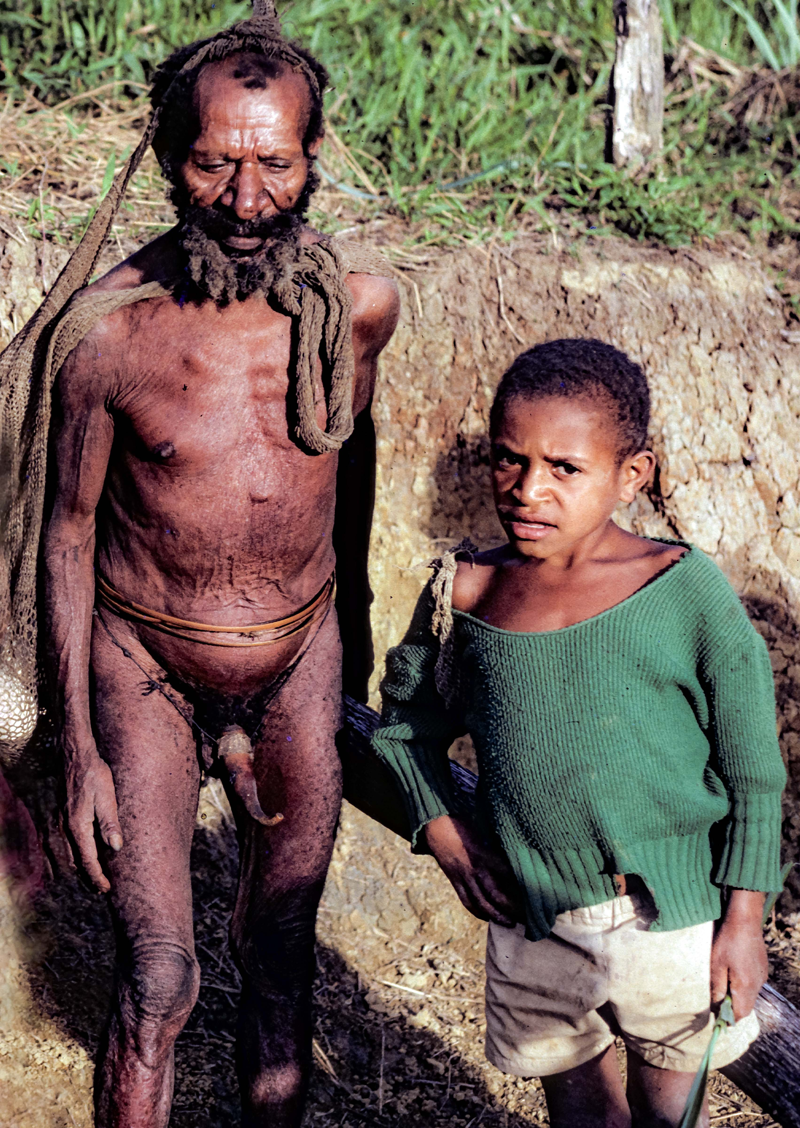 PNG, Oksapmin Man With Penis Gourd And Boy, 1983