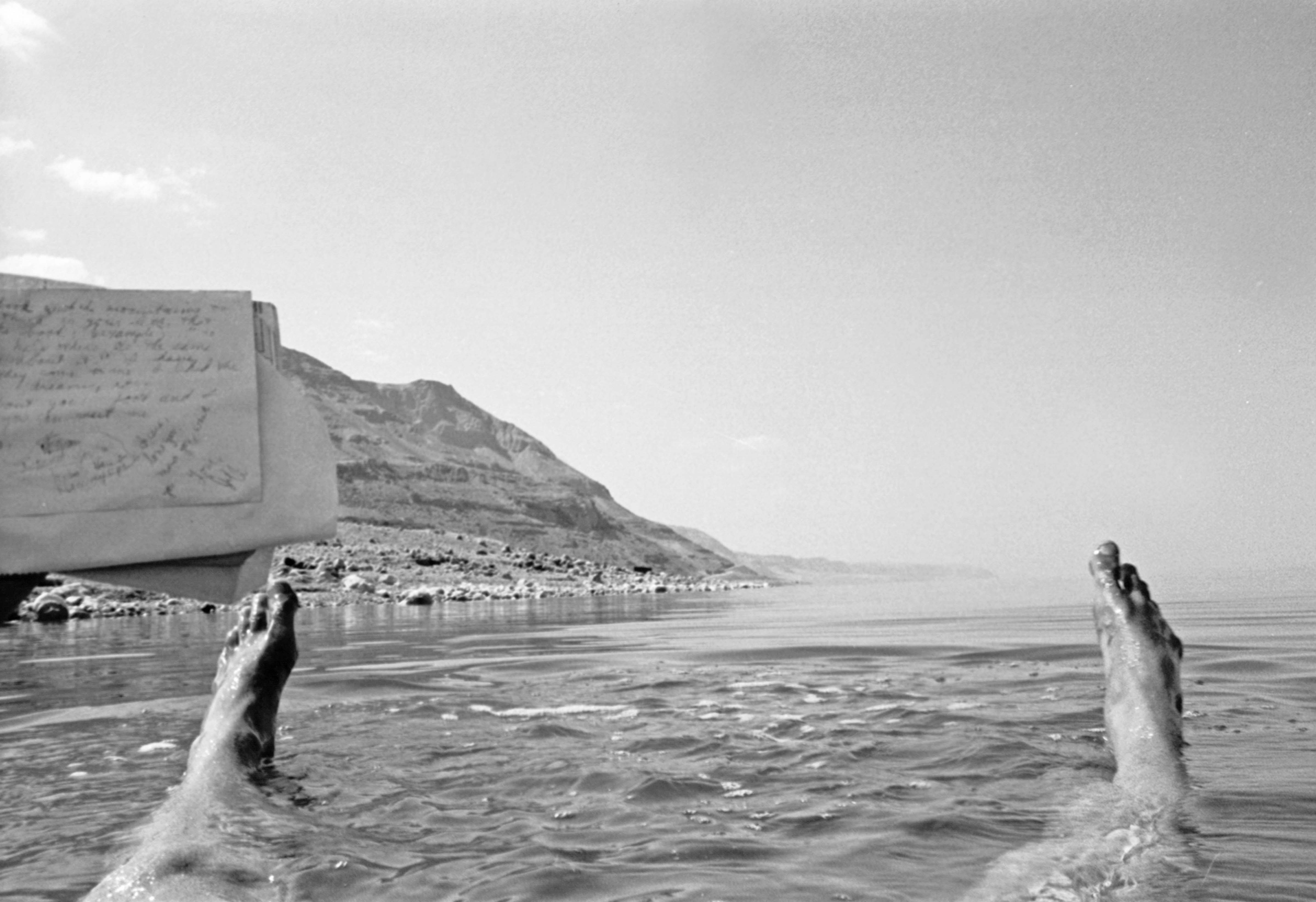 Palestine, Jeff Shea Writing Love Letter While Floating In Dead Sea, 1984