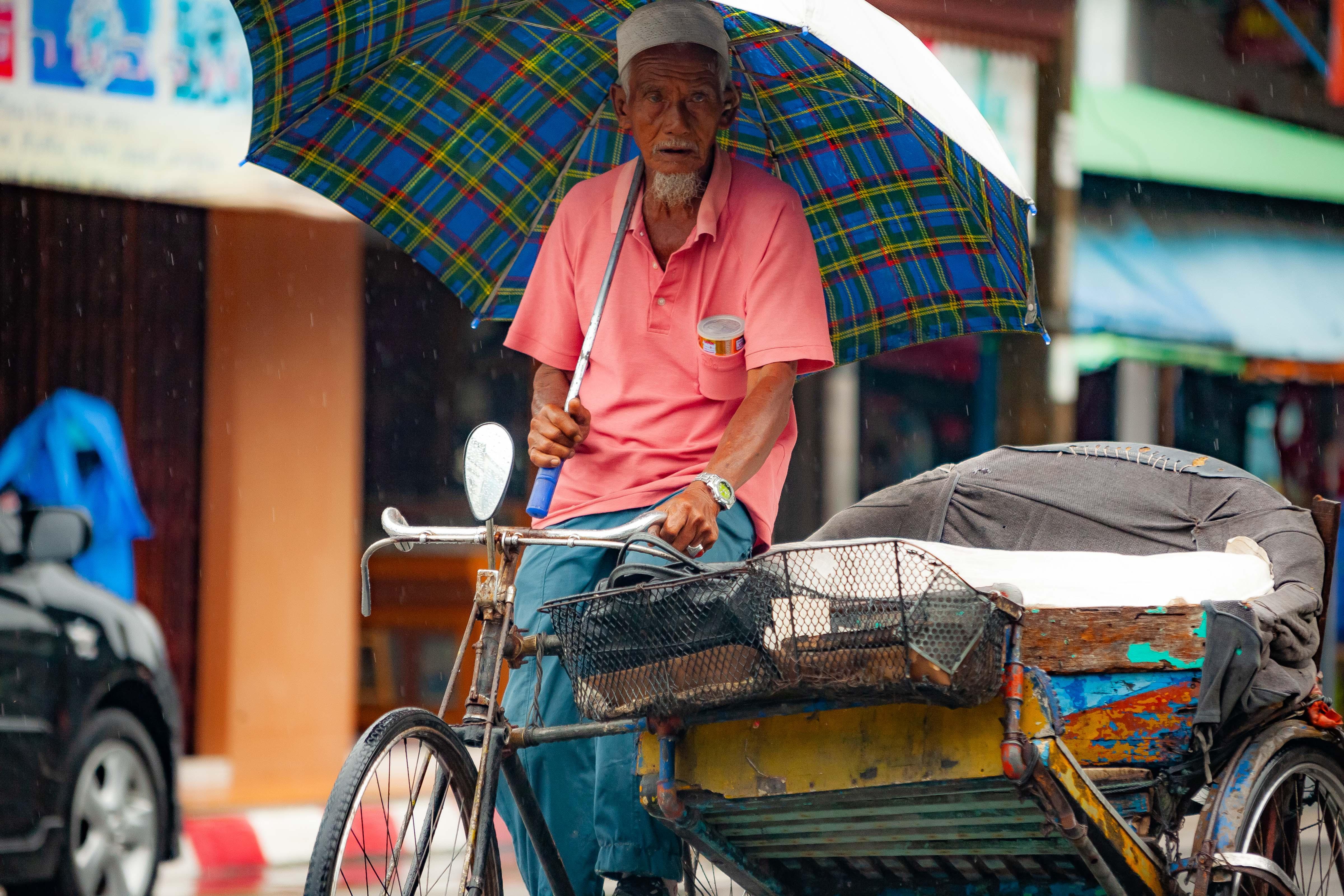 Thailand, Narathiwat Prov, Ricksha Driver In Rain, 2008, IMG 1641