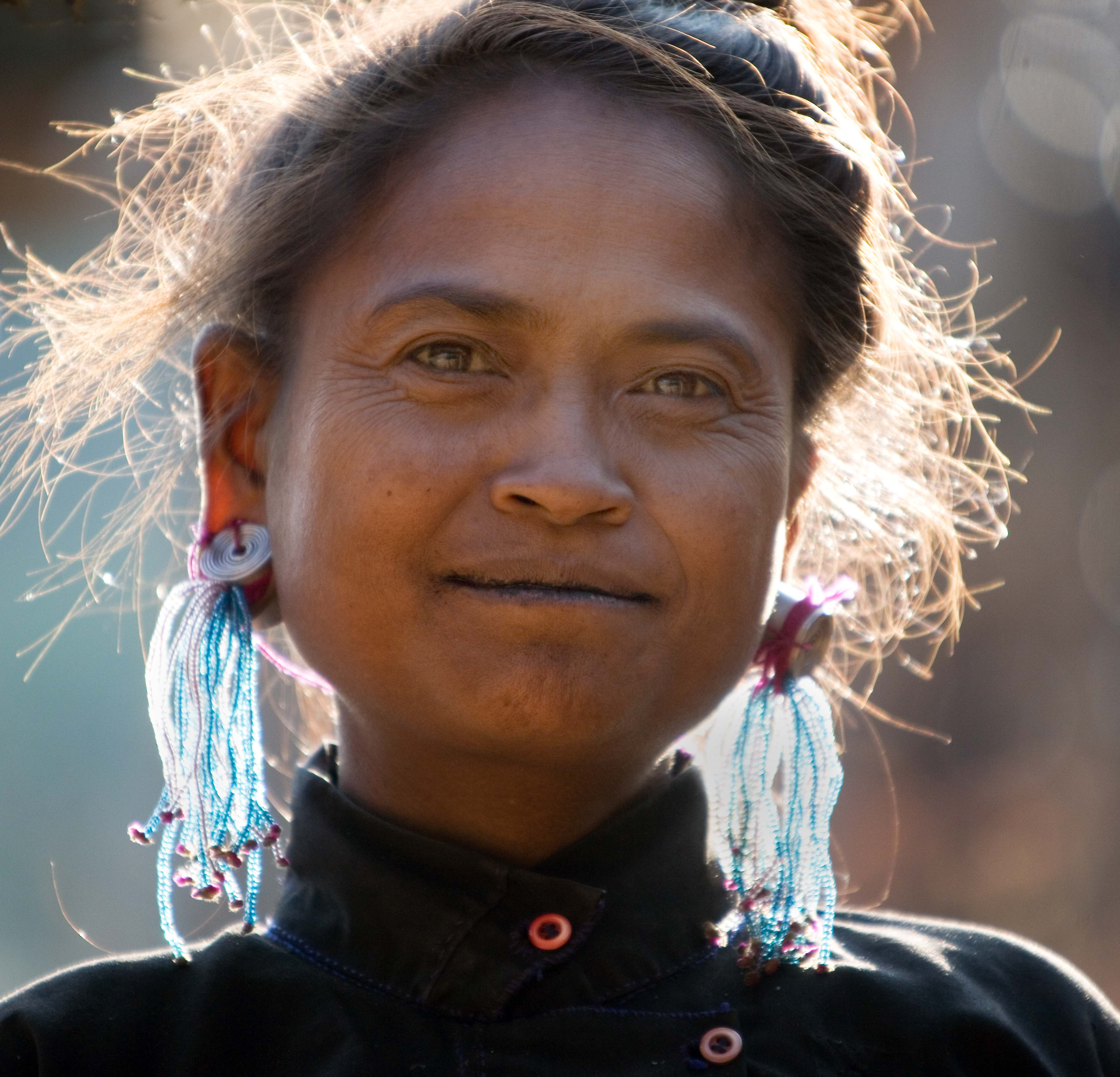 Eng Woman with Glass Bead Earrings in Sun